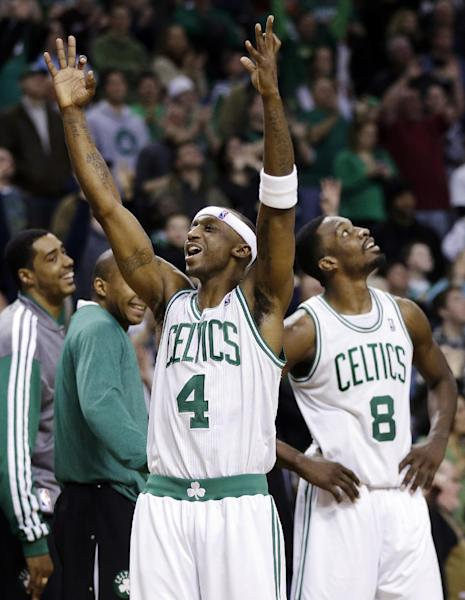 Boston Celtics guard Jason Terry (4) reacts to the crowd as forward Jeff Green (8) looks up at the scoreboard during a timeout near the end of the second overtime of an NBA basketball game against the Denver Nuggets in Boston, Sunday, Feb. 10, 2013. The Celtics won 118-114 in triple overtime. (AP Photo/Elise Amendola)