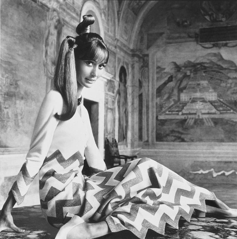 """Madame Philippe Leroy (Silvia Tortora) in """"zigzag gold lamé stripes tinseling white jersey—to pointed wrist, pointed hem. Evening dress by Mila Schön, in Agnona fabric designed by Mila Schön."""""""
