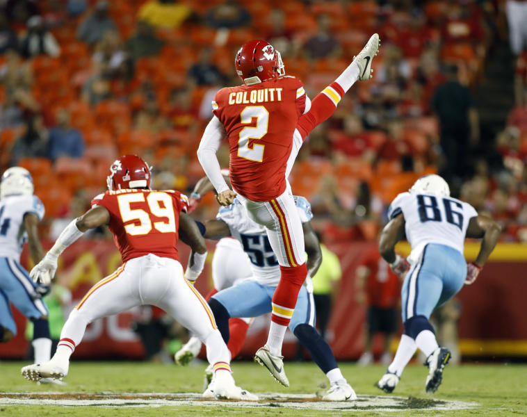 FILE - In this Aug. 31, 2017, file photo, Kansas City Chiefs' Dustin Colquitt (2) punts during the first half of an NFL preseason football game against the Tennessee Titans, in Kansas City, Mo. On Sunday, Sept. 22, 2019 Colquitt will suit up for the 225th time in a Chiefs uniform, surpassing Will Shields for the franchise record. (AP Photo/Colin E. Braley, File)