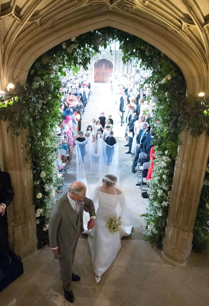 Prince Charles escorts Meghan Markle down the aisle at her wedding to Prince Harry