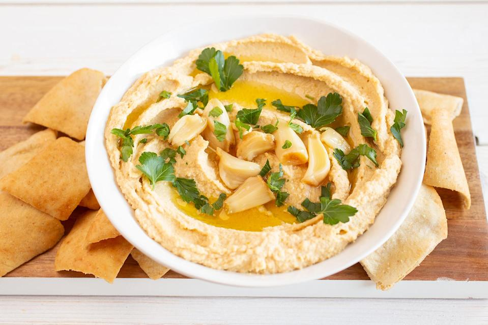 <p>Two entire heads of garlic might seem like an awful lot to add to a bowl of dip, but don't fear. When roasted, the pungent cloves mellow out for a rich but not-too-overpowering hummus.</p>