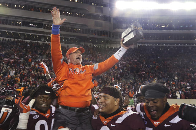 Virginia Tech defensive coordinator Bud Foster holds the lunchpail as he is carried off the field after Virginia Tech's 36-17 win over Wake Forest in an NCAA college football game in Blacksburg, Va., Saturday, Nov. 9, 2019. (AP Photo/Steve Helber)