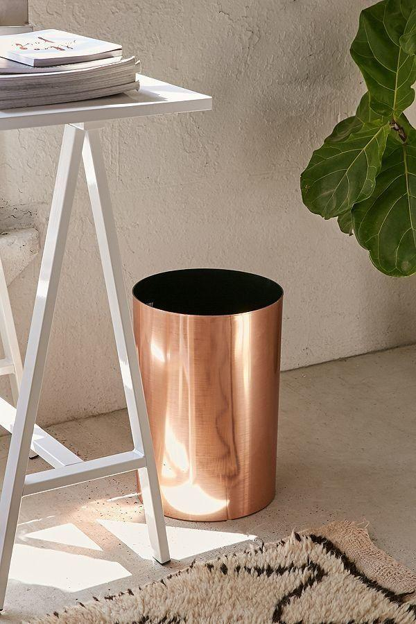 "Get it <a href=""https://www.urbanoutfitters.com/shop/umbra-matilda-trash-can?category=bathroom-accessories&color=028"" target=""_blank"">here</a> for $24."
