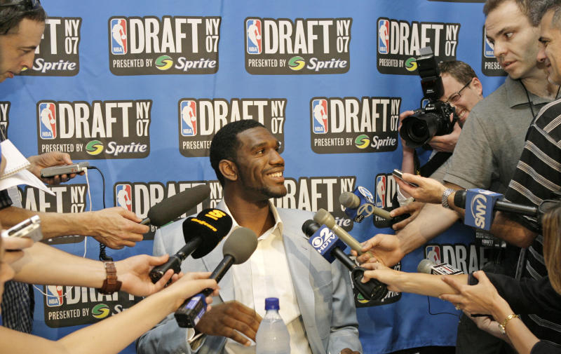 FILE - In this June 27, 2007, file photo, Ohio State's Greg Oden answers reporters' questions the day before the NBA Draft in New York. The 7-footer averaged 15.7 points, 9.6 rebounds and 3.3 blocks for Ohio State before the Portland Trail Blazers took him with the No. 1 pick in the 2007 draft. (AP Photo/Kathy Willens, File)