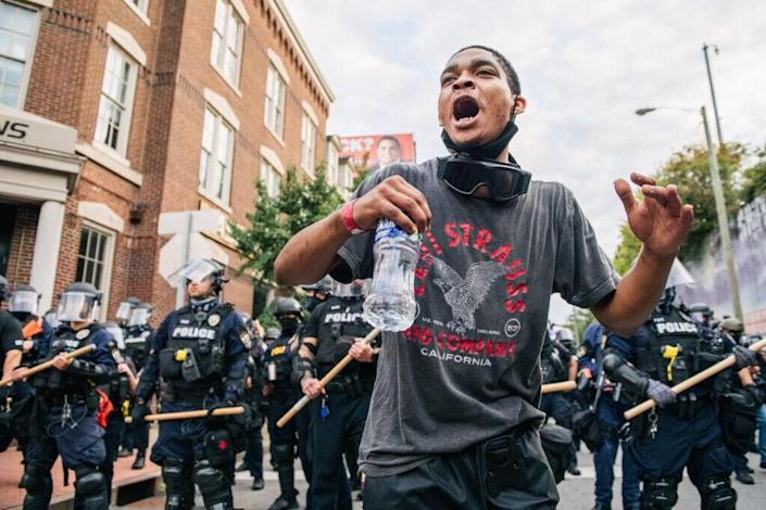 A demonstrator motions to protestors during a rally on September 23, 2020 in Louisville, Kentucky. (Photo by Brandon Bell/Getty Images)