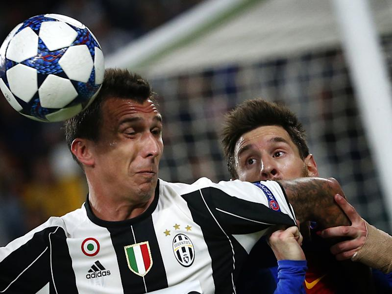 Lionel Messi battles with Mario Mandzukic for the ball: Getty