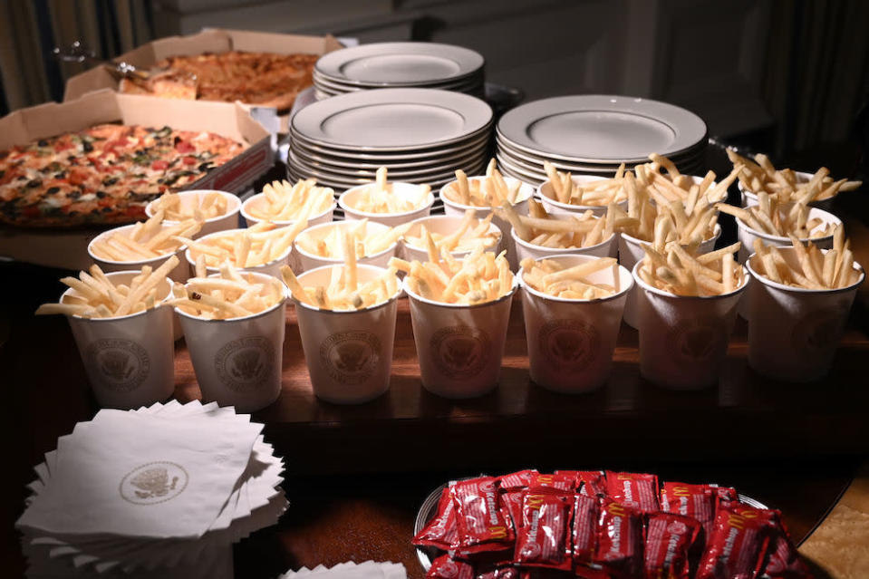 French fries and pizza were some of the fast food items for the reception (Picture: AP)
