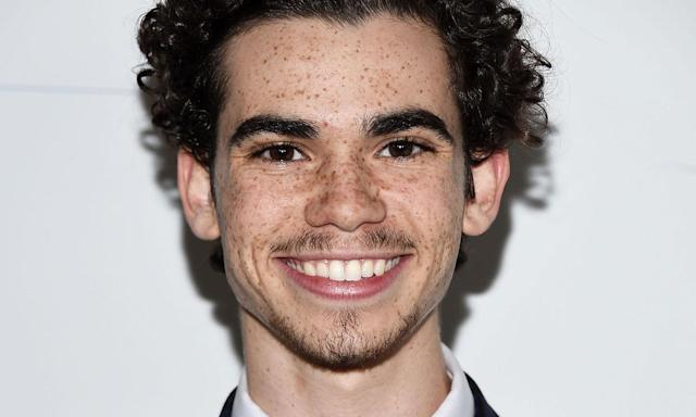 "Disney star Cameron Boyce tragically <a href=""https://uk.news.yahoo.com/disney-star-cameron-boyce-dies-in-sleep-age-20-092920525.html"" data-ylk=""slk:died in his sleep aged just 20;outcm:mb_qualified_link;_E:mb_qualified_link"" class=""link rapid-noclick-resp yahoo-link"">died in his sleep aged just 20</a> following an epileptic seizure. Before his death, he'd featured in Disney Channel series <em>Jessie</em> and in the three <em>Descendants</em> movies. Many celebrities paid tribute to Boyce, including former First Lady Michelle Obama who had met the actor in 2014. (Photo by Amanda Edwards/WireImage)"