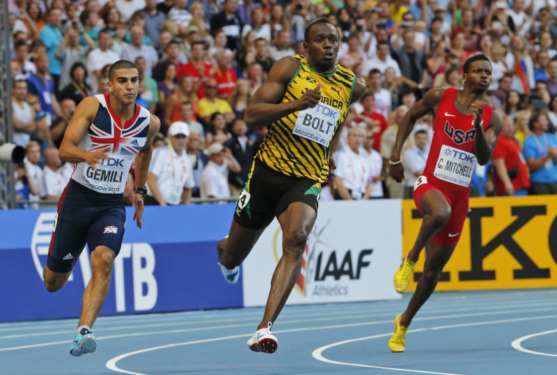 From left, Britain's Adam Gemili, Jamaica's Usain Bolt, and United States' Curtis Mitchell compete in the men's 200-meter final at the World Athletics Championships in the Luzhniki stadium in Moscow, Russia, Saturday, Aug. 17, 2013. (AP Photo/Misha Japaridze)