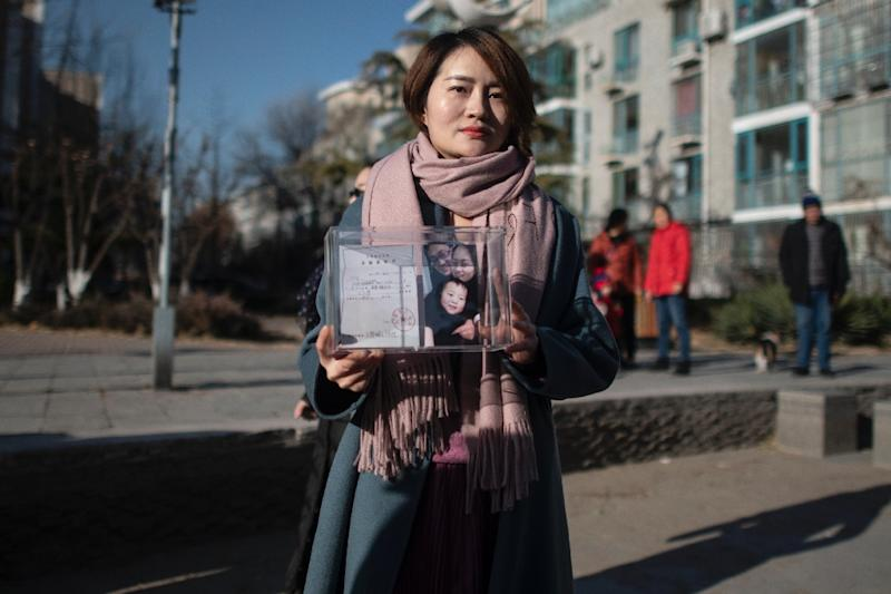 Li Wenzu attempted to march 100 kilometres (60 miles) to a detention facility in neighbouring Tianjin to highlight her husband's plight (AFP Photo/FRED DUFOUR)