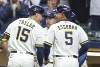 Milwaukee Brewers' Tyrone Taylor and teammate Eduardo Escobar react after Taylor's grand slam against the St. Louis Cardinals during the first inning of a baseball game Thursday, Sept. 23, 2021, in Milwaukee. (AP Photo/Jeffrey Phelps)