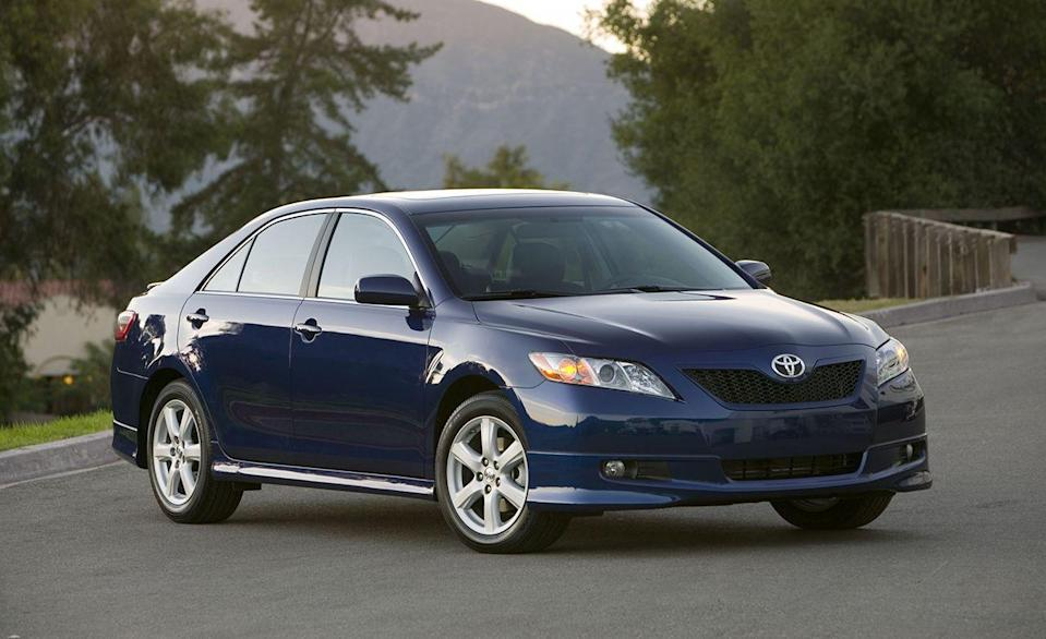 """<p>By the end of the noughts, redesigns of the Camry had became a predictable affair. Each one was bigger, more powerful, and better equipped than before, and the sixth-generation car was no different. When the new Camry arrived in 2007, Toyota promptly sold more examples in the '07 calendar year than any Camry before, sending 473,108 units to new homes. The base 158-hp 2.4-liter four-cylinder was mostly carryover, but the 3.3-liter V-6 was dropped in favor of an all-new 3.5-liter engine with a whopping 268 horsepower that endowed the Camry with serious speed. We pit one Camry so equipped against a turbocharged all-wheel-drive Subaru WRX in <a href=""""https://www.caranddriver.com/features/a15148575/surprise-speed-tournament-feature/"""" rel=""""nofollow noopener"""" target=""""_blank"""" data-ylk=""""slk:our """"Surprise Speed"""" tournament"""" class=""""link rapid-noclick-resp"""">our """"Surprise Speed"""" tournament</a>, and the unassuming Toyota easily kept up, sprinting from zero-to-60 mph in 5.8 seconds and running the quarter-mile in a scant 14.3 seconds at 99 mph. <br></p>"""