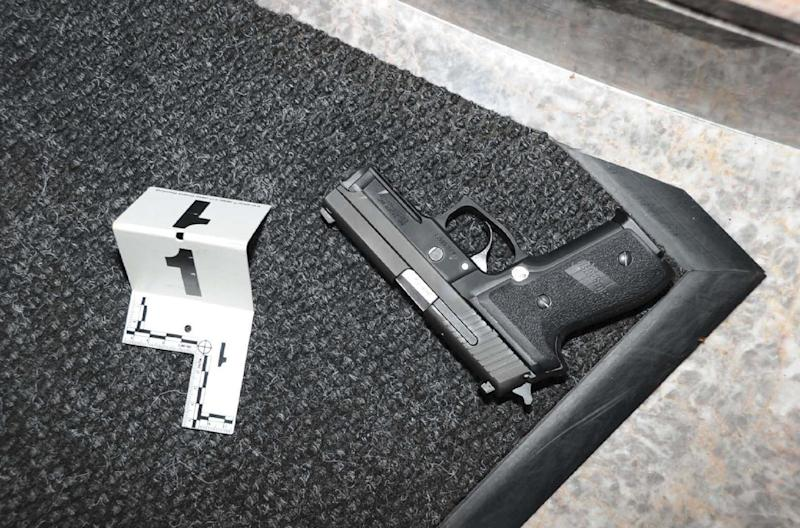 This handout photo provided by the US Attorney's office shows a gun at the scene where Floyd Corkins II shot a security guard at the Family Research Council in Washington last year. Prosecutors say a Virginia man who planned a mass killing at the Washington headquarters of a conservative Christian lobbying group should spend 45 years in prison for his plot. Corkins pleaded guilty to three charges in February: interstate transportation of a firearm, assault with intent to kill while armed and committing an act of terrorism while armed. The first charge carries a maximum of 10 years in prison and the two other charges carry a maximum 30 years in prison. Sentencing is set for April 29. (AP Photo/US Attorney's office)