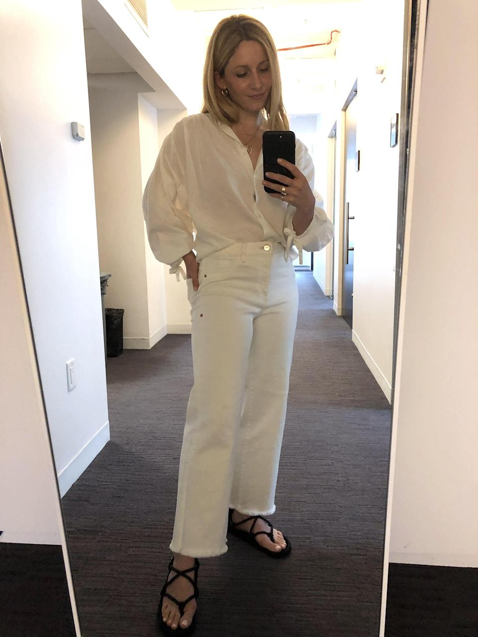 """<p>""""I've had an up-and-down relationship with white jeans. There have been stretchy styles I loved that I later saw pictures of myself in and realized they were not so flattering and more rigid cuts I've tried that never quite felt comfortable enough to wear more than once or twice. Finally, I came across <a href=""""https://www.warpweftworld.com/collections/white-denim-00-24/products/icn-wide-leg-ecru"""" rel=""""nofollow noopener"""" target=""""_blank"""" data-ylk=""""slk:this pair by Warp + Weft"""" class=""""link rapid-noclick-resp"""">this pair by Warp + Weft</a>, which has an amazing size range for all body types. I found that this wide-leg silhouette flatters my shape well. It has stretch, but only enough to feel comfortable while being supportive enough up top where I need it. I'll definitely be wearing these all Summer long with everything from white tops to bohemian blouses and simple tank tops."""" - Laura Lajiness, senior editor, Fashion</p>"""