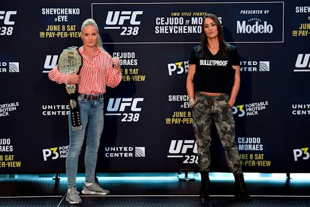 Valentina Shevchenko (L) and Jessica Eye pose for the media during the UFC 238 Ultimate Media Day at the United Center on June 6, 2019 in Chicago, Illinois. (Getty Images)