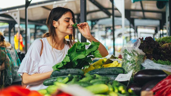 Young cheerful woman at the market.
