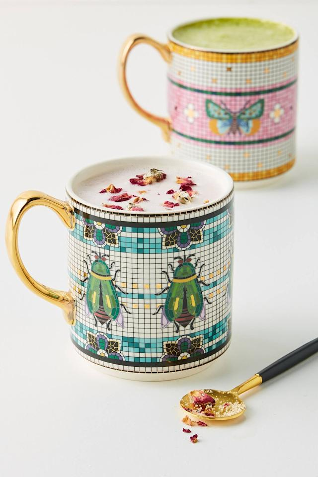 "<p>Your morning coffee or tea will be even better in this <a href=""https://www.popsugar.com/buy/Garden-Tile-Mug-559917?p_name=Garden%20Tile%20Mug&retailer=anthropologie.com&pid=559917&price=14&evar1=savvy%3Aus&evar9=47338352&evar98=https%3A%2F%2Fwww.popsugar.com%2Fhome%2Fphoto-gallery%2F47338352%2Fimage%2F47338572%2FGarden-Tile-Mug&list1=shopping%2Cgift%20guide%2Cproducts%20under%20%2425&prop13=api&pdata=1"" rel=""nofollow"" data-shoppable-link=""1"" target=""_blank"" class=""ga-track"" data-ga-category=""Related"" data-ga-label=""https://www.anthropologie.com/shop/garden-tile-mug?category=holiday-gifts-under-25&amp;color=066&amp;type=STANDARD"" data-ga-action=""In-Line Links"">Garden Tile Mug</a> ($14).</p>"