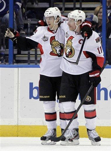 Ottawa Senators defenseman Erik Karlsson (65), of Sweden, celebrates with right wing Daniel Alfredsson (11), of Sweden, after scoring against the Tampa Bay Lightning during the second period of an NHL hockey game Tuesday, March 6, 2012, in Tampa, Fla. (AP Photo/Chris O'Meara)