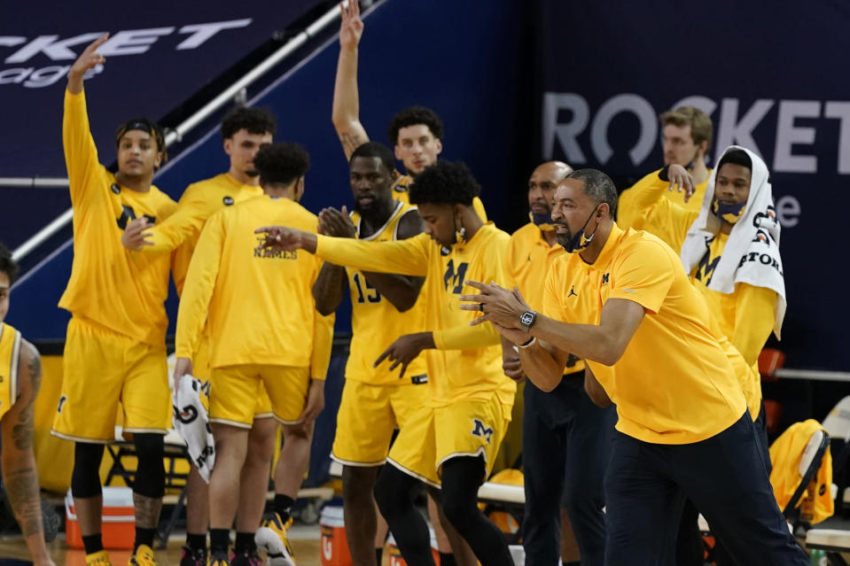The Michigan bench reacts after a play during the first half of an NCAA college basketball game against Michigan State, Thursday, March 4, 2021, in Ann Arbor, Mich. (AP Photo/Carlos Osorio)