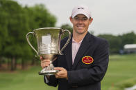 Rory McIlroy holds the trophy after winning during the fourth round of the Wells Fargo Championship golf tournament at Quail Hollow on Sunday, May 9, 2021, in Charlotte, N.C. (AP Photo/Jacob Kupferman)