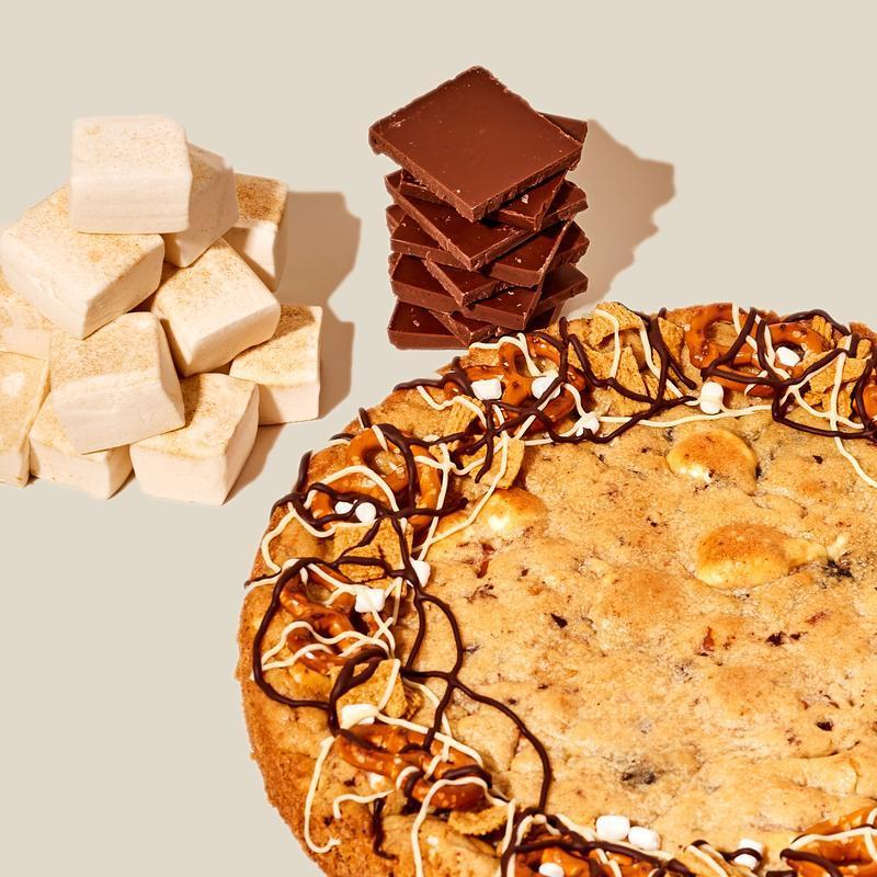 """<h2>Milk Bar The S'mores On S'mores Kit</h2><br>Milk Bar whipped up some camping dessert classic with a gourmet twist just for Father's Day (that will deliver straight to Dad's doorstep fresh and ready).<br><br><em>Shop</em> <strong><em><a href=""""http://milkbar.com"""" rel=""""nofollow noopener"""" target=""""_blank"""" data-ylk=""""slk:Milk Bar"""" class=""""link rapid-noclick-resp"""">Milk Bar</a></em></strong><br><br><strong>Milk Bar</strong> The S'mores On S'mores Kit, $, available at <a href=""""https://go.skimresources.com/?id=30283X879131&url=https%3A%2F%2Fmilkbarstore.com%2Fcollections%2Ffathers-day-shop%2Fproducts%2Fsmores-kit"""" rel=""""nofollow noopener"""" target=""""_blank"""" data-ylk=""""slk:Milk Bar"""" class=""""link rapid-noclick-resp"""">Milk Bar</a>"""