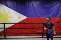 Standing in front of a large Filipino flag, boxer Manny Pacquiao smiles while training at the Wild Card Boxing Club Monday, Jan. 14, 2019, in Los Angeles. The Filipino legend is in the winter of his career, gearing up for what could be one big last fight. Saturday's bout versus Broner isn't it, but Pacquiao trains with the knowledge that a second megafight against Floyd Mayweather could possibly be just months away if all goes well. (AP Photo/Jae C. Hong)