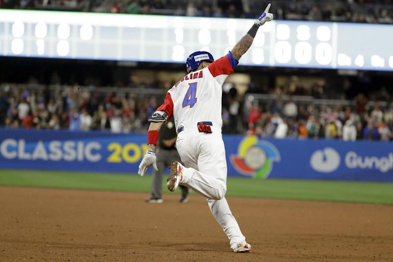 Puerto Rico's Yadier Molina reacts as he rounds first base after hitting a home run during the sixth inning of a second-round World Baseball Classic game against the Dominican Republic on Tuesday, March 14, 2017, in San Diego. (AP Photo/Gregory Bull)