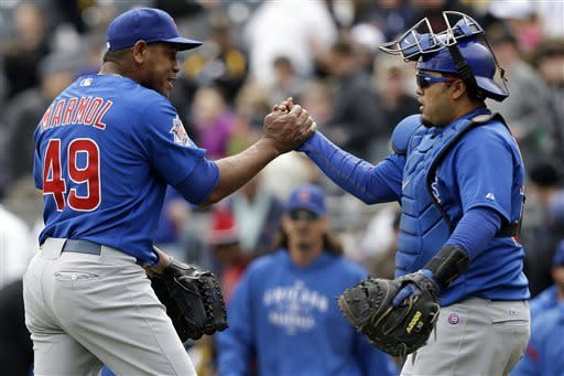 Chicago Cubs relief pitcher Carlos Marmol, left, celebrates with catcher Dioner Navarro after getting the final out in the ninth inning to preserve a 3-2 win over the Pittsburgh Pirates in a baseball game in Pittsburgh, Thursday, April 4, 2013. (AP Photo/Gene J. Puskar)