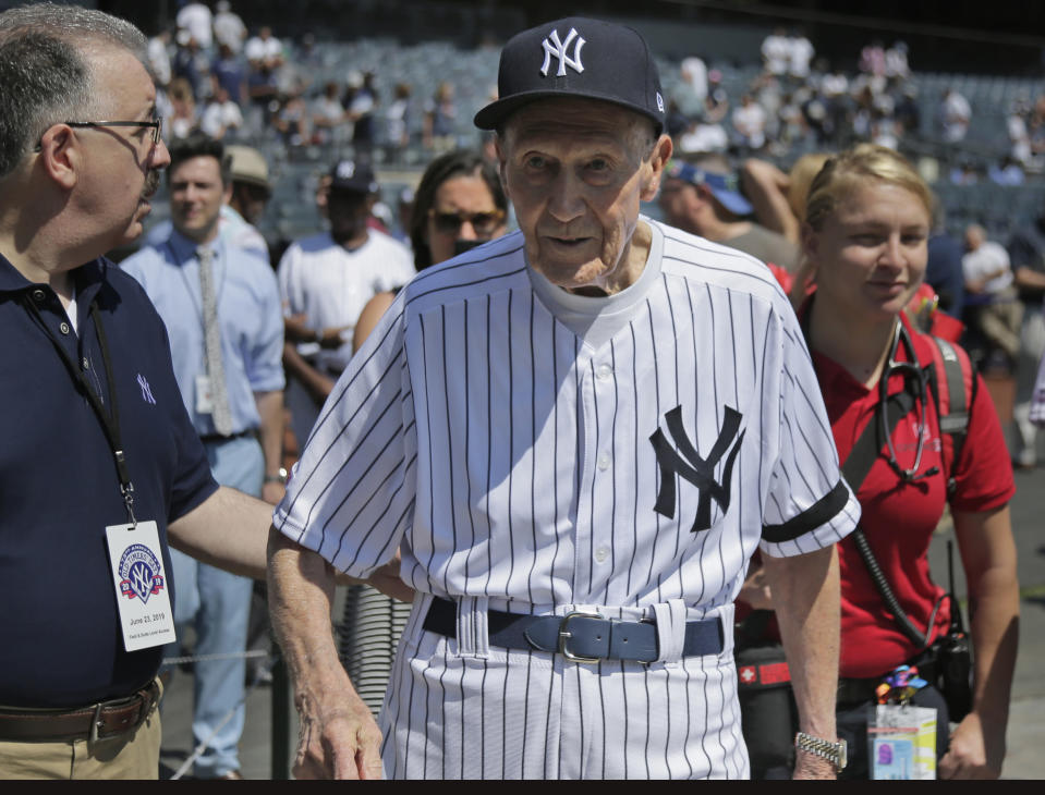 FILE - Former New York Yankees baseball player Bobby Brown walks on the field during Old Timer's Day at Yankee Stadium in New York, in this Sunday, June 23, 2019, file photo. Bobby Brown, who won five World Series as an infielder with the New York Yankees and later became president of the American League, has died at age 96. The Yankees said that Brown died on Thursday morning, March 25, 2021, in Fort Worth, Texas. (AP Photo/Seth Wenig, File)