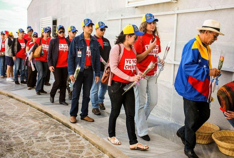 Cubans queue in Revolution Square in Havana to attend the posthumous tribute to late Venezuelan President Hugo Chavez on March 7, 2013. Cuba's leaders gave Hugo Chavez a send-off fit for one of their own Thursday, with huge crowds turning out to pay homage to the late Venezuelan leader in Havana and Santiago's Revolution Plaza