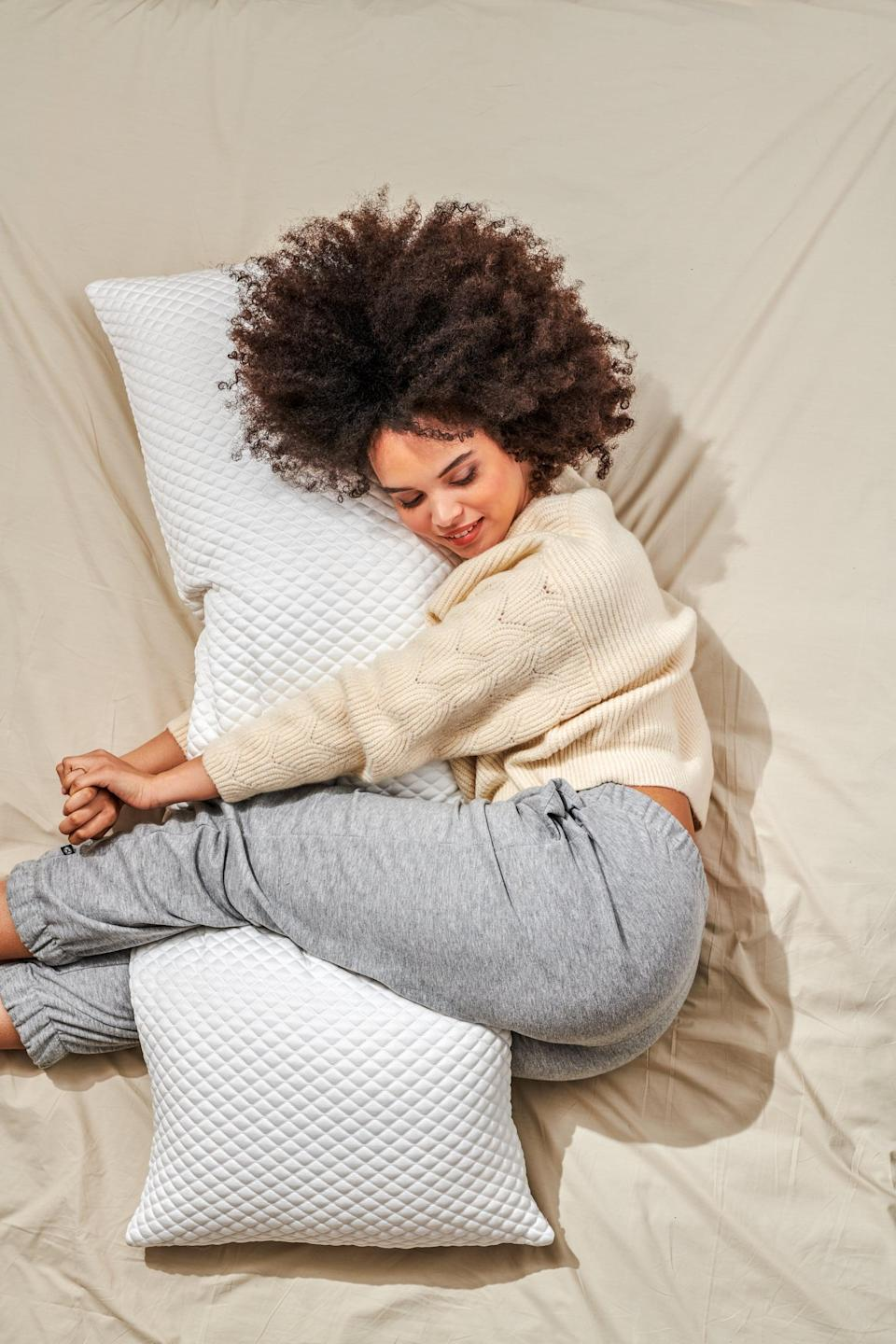 <p>The biggest game changer for my quality of sleep was the <span>Pluto Puff Pillow</span> ($95), an extremely comfortable body pillow. I'd previously been using a <span>pregnancy pillow</span> but found it too stiff, especially when I would try to reposition in the middle of the night. In contract, the Puff is a dream to hug at night! At 12 pounds, 21' wide by 54' long, it provides just the right amount of side and leg support leading to less middle of the night aches (I was previously waking up every few hours with very sore hips.) </p>
