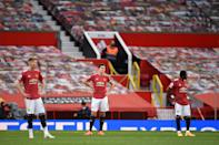 Manchester United's Scott McTominay, Harry Maguire (C) and Fred (R) react after Tottenham scored their fifth goal during the English Premier League football match between Manchester United and Tottenham Hotspur at Old Trafford in Manchester, north west England, on October 4, 2020. (Photo by Oli SCARFF / AFP) / RESTRICTED TO EDITORIAL USE. No use with unauthorized audio, video, data, fixture lists, club/league logos or 'live' services. Online in-match use limited to 120 images. An additional 40 images may be used in extra time. No video emulation. Social media in-match use limited to 120 images. An additional 40 images may be used in extra time. No use in betting publications, games or single club/league/player publications. / (Photo by OLI SCARFF/AFP via Getty Images)