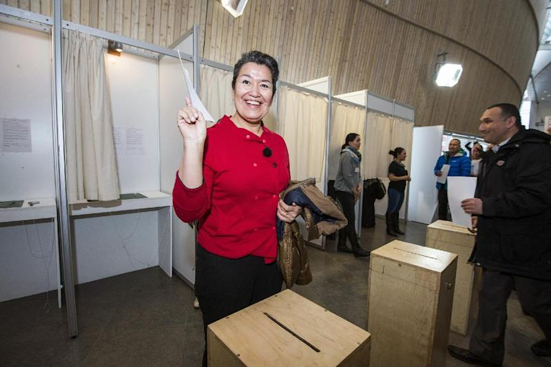 Aleqa Hammond from Siumut casting her vote during the general election, in Nuuk, Greenland Tuesday, March 12, 2013. Voting stations opened in Greenland to elect the semi-autonomous nation's 31-seat Parliament amid a strategic debate over how to handle potentially vast underground mineral wealth. Left-leaning Premier Kuupik Kleist wants to maintain a zero-tolerance policy on mining radioactive minerals, a byproduct of extracting rare earth metals, while challenger Aleqa Hammond — potentially Greenland's first female head of government — is prepared to tap them.(AP Photo/Polfoto, Sermitsiaq, Leiff Josefsen) DENMARK OUT