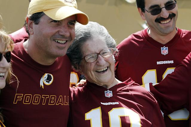Washington Redskins owner Dan Snyder, left, poses for a photograph with Melba Jacobson, from Silver Spring, Md., who is celebrating her upcoming 90th birthday, after practice at the team's NFL football training facility, Monday, July 28, 2014 in Richmond, Va. (AP Photo/Alex Brandon)