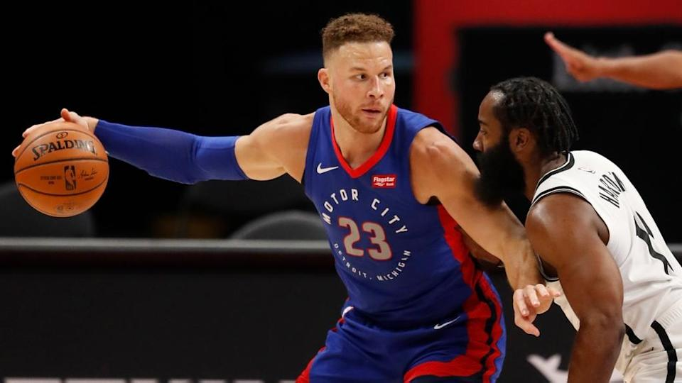 Blake Griffin handles the ball with Pistons guarded by James Harden close crop
