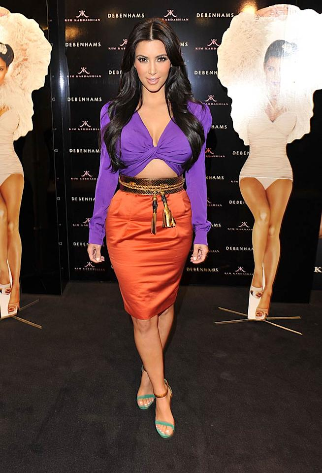 "What do you make of the purple, midriff-baring top, tassel-enhanced belt, and coral-colored skirt reality TV titan Kim Kardashian donned for the launch of her new scent at Debenhams department store in London, England? Jon Furniss/<a href=""http://www.wireimage.com"" target=""new"">WireImage.com</a> - June 8, 2011"