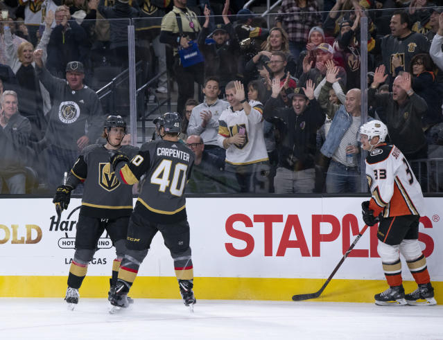 Vegas Golden Knights center Cody Eakin (21) celebrates his goal with teammate Ryan Carpenter (40) during the second period of an NHL hockey game against the Anaheim Ducks on Wednesday, Nov. 14, 2018, in Las Vegas. (AP Photo/Eric Jamison)