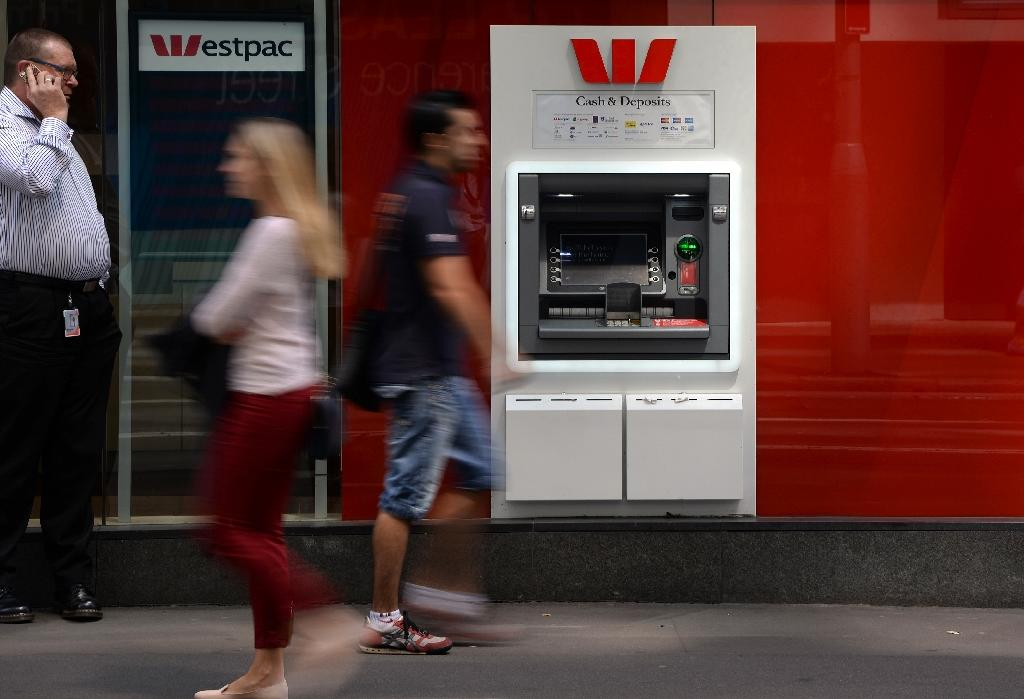 Westpac Bank shares savaged as interim profit inches up