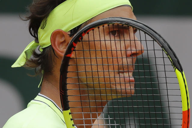 Spain's Rafael Nadal grimaces after scoring against Switzerland's Roger Federer during their semifinal match of the French Open tennis tournament at the Roland Garros stadium in Paris, Friday, June 7, 2019. (AP Photo/Michel Euler)