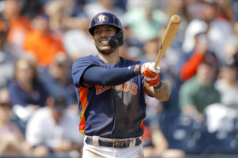 Houston Astros' Carlos Correa reacts after fouling a pitch from Detroit Tigers pitcher Tarik Skubal during the second inning of a spring training baseball game, Monday, March 9, 2020, in West Palm Beach, Fla. (AP Photo/Julio Cortez)