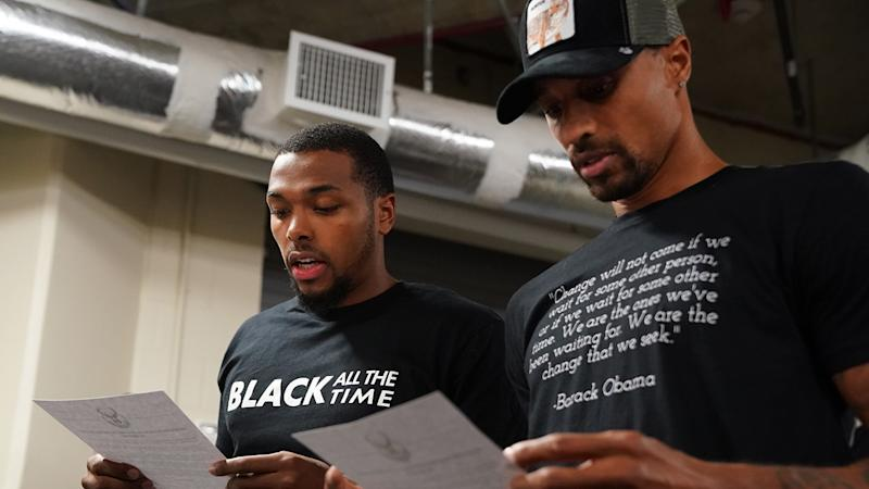 Sterling Brown and George Hill of the Milwaukee Bucks read a statement to the media after electing not to play game five of their playoff series against Orlando, in protest of the police shooting of Jacob Blake. (Photo by Jesse D. Garrabrant/NBAE via Getty Images)