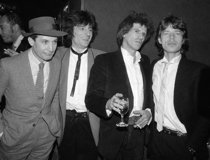 """FILE - Members of the Rolling Stones, from left, Charlie Watts, Ron Wood, Keith Richards, and Mick Jagger appear at a party celebrating the opening of their film """"Let's Spend The Night Together,"""" in New York on Jan. 18, 1983. Watts' publicist, Bernard Doherty, said Watts passed away peacefully in a London hospital surrounded by his family on Tuesday, Aug. 24, 2021. He was 80. (AP Photo/Carlos Rene Perez, File)"""