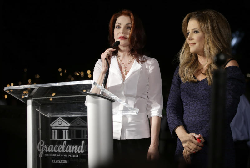 Priscilla Presley, left, Elvis Presley's ex-wife, and Lisa Marie Presley, right, the daughter of Elvis and Priscilla Presley, speak to fans gathered at a candlelight vigil at Graceland, Elvis Presley's Memphis, Tenn. home, on Wednesday, Aug. 15, 2012. Fans from around the world are at Graceland to commemorate the 35th anniversary of Elvis Presley's death. (AP Photo/Mark Humphrey)
