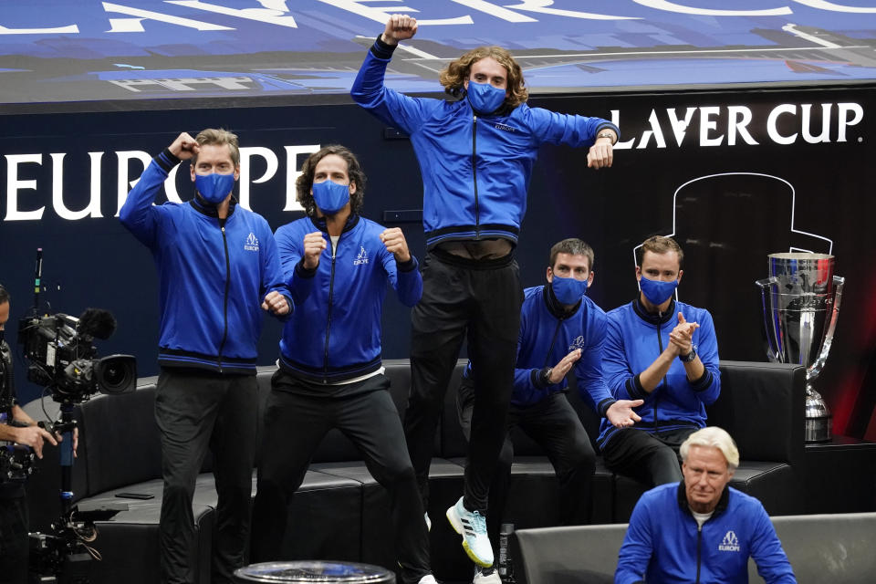 Team Europe players cheer after Casper Ruud, of Norway, defeated Team World's Reilly Opelka, of the USA, at Laver Cup tennis, Friday, Sept. 24, 2021, in Boston. (AP Photo/Elise Amendola)