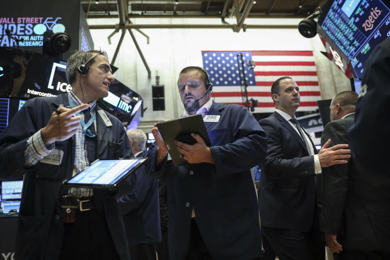 NEW YORK, NY - AUGUST 19: Traders and financial professionals work on the floor of the New York Stock Exchange (NYSE) at the opening bell on August 19, 2019 in New York City. The Dow Jones Industrial Average traded over 300 points higher at the open on Monday morning. (Photo by Drew Angerer/Getty Images)