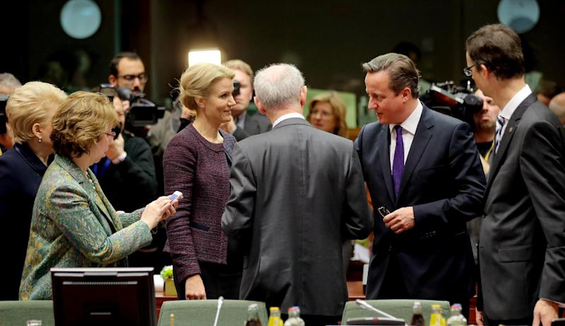 From left, Lithuanian President Dalia Grybauskaite, European Union High Representative Catherine Ashton, Danish Prime Minister Helle Thorning-Schmidt, European Council President Herman Van Rompuy, British Prime Minister David Cameron and General Secretariat of the Council Uwe Corsepius during a round table meeting at an EU summit on Friday, Oct. 25, 2013. Migration, as well as an upcoming Eastern Partnership summit will top the agenda in Friday's meeting of EU leaders. (AP Photo/Michel Euler)
