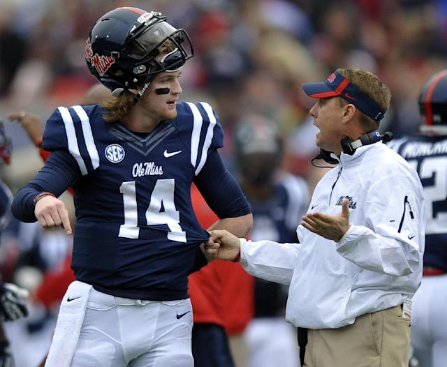 Mississippi quarterback Bo Wallace (14) talks with coach Hugh Freeze during an NCAA college football game against Troy in Oxford, Miss., Saturday, Nov. 16, 2013. (AP Photo/Oxford Eagle, Bruce Newman)