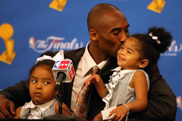 Kobe Bryant kisses daughter Gianna in a press conference after the Lakers' win over the Boston Celtics in Game Five of the 2008 NBA Finals on June 15, 2008 at Staples Center in Los Angeles, California. (Photo by Jed Jacobsohn/Getty Images)