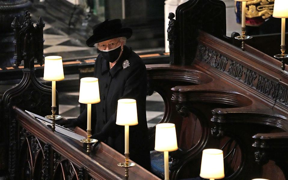 Queen Elizabeth II watches as pallbearers carry the coffin of Prince Philip, Duke Of Edinburgh into St George's Chapel - Getty Images Europe