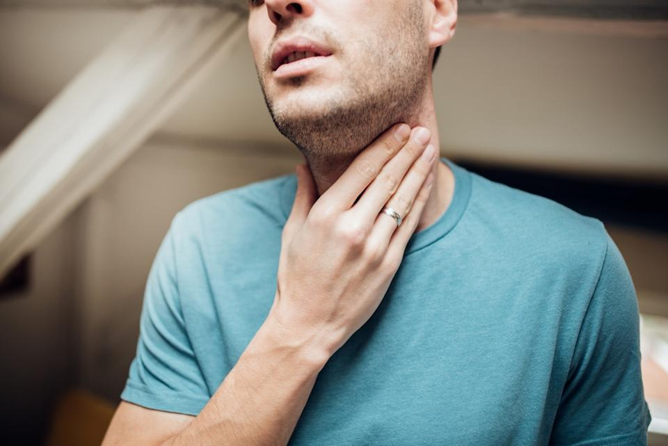 Young man with a sore throat